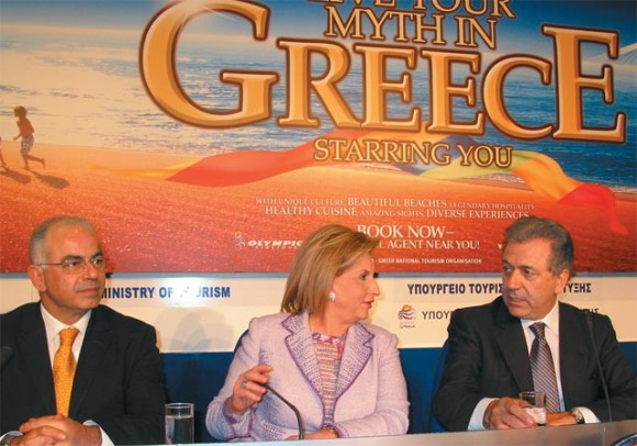 The new tourism development minister, Fani Palli-Petralia with outgoing minister, Dimitris Avramopoulos.