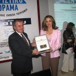 Xanthi Prefect Yiorgos Pavlides accepts the honorary award from Member of Parliament Angela Gerekou, responsible for tourism issues for PASOK party.