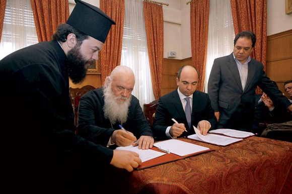 His Beatitude Archbishop of Athens and All Greece Ieronimos and Travel Plan's CEO George Daskalakis during the signing of the memorandum of understanding that is expected to attract worshippers from abroad to Athens.