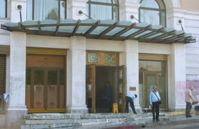 "Employees of the King George hotel on Syntagma Square pick up the pieces after the violent anti-austerity protests. On 29 June the hotel was evacuated ""due to the uncontrolled nature of events taking place at Syntagma Square."""