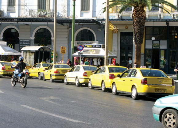Greek taxi owners and drivers are protesting against the government's proposed law to liberalize the taxi sector and lift all restrictions on the number of licenses issued.