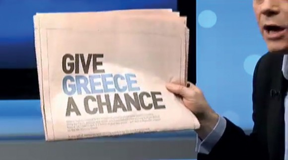 """A newspaper with the """"Greece is Changing"""" ad printed."""