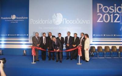 Caretaker Prime Minister Panagiotis Pikrammenos cuts the ribbon during the official opening ceremony of the 23rd Posidonia International Shipping Exhibition.