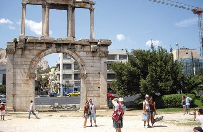 "Tourists seen at the monumental gateway of Hadrian's arch in the center of Athens. Upon releasing data on bookings in the Greek capital, the Athens-Attica Hotel Association recently referred to ""a depressing performance of the destination and its hotels."""
