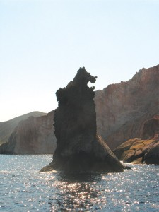 "When sailing around Milos visitors will see many unusual rock formations that protrude from the sea and stand near Adamas harbor. Pictured is a rock that is referred to as ""Arkouda"" as it resembles a bear."