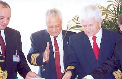 Rafik Ilyasov, Uzbekistan Airways' general manager for Greece, waits to serve his guests a piece of the airline's inauguration cake. To his right are: Zahredin Payziyev, the carrier's flight division director; Boris Besedin, the carrier's deputy general director; and Yiannis Charalambakis, the senior director at Athens Airport.