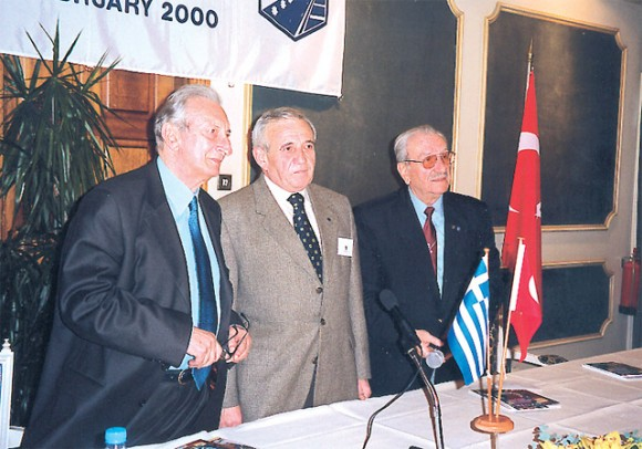 Skal Club Turkey President Halit Cura, , and National Committee Skal Clubs Greece President Spyros Katehis (Skal Club Rodos). At the podium, Athens member Michael Coveas of the International Skal Council.