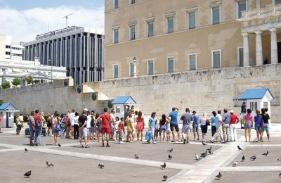 Tourists gathered in front of the Parliament building on Syntagma Square and wait to watch the Changing of the Guard ceremony at the Tomb of the Unknown Soldier in central Athens. According to the Tourism Ministry, the city's tourism development will include a strategy that will extend to neighborhoods throughout the city and not be not limited to the historic center.