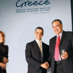 Actress Evelina Papoulia with tourism development minister, Aris Spiliotopoulos and the prefect of Chalkidiki, Asterios Zografos. Chalkidiki received two awards.