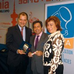 Stefanos Vlastos, special secretary to the tourism ministry, and Andreas Stylianopoulos, vice-president and general manager of Navigator, with Ms. Phili during award ceremonies.