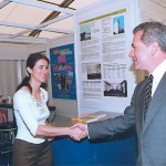 GTP's Maria Theofanopoulos welcomes the mayor of Athens, Dimitris Avramopoulos, to Panorama 2000 and to the Greek Travel Pages' stand.