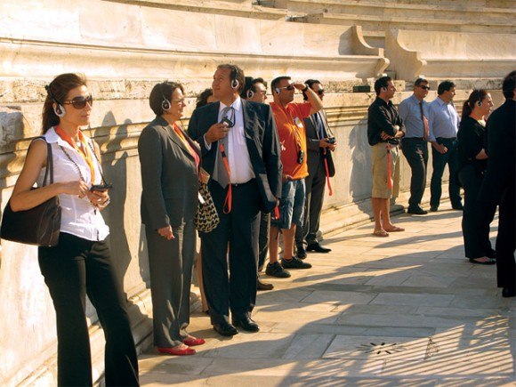 "Hellenic Olympic Committee Spyros Kapralos (third from left) accompanied tourism professionals during an organized tour of the Panathenaic stadium. ""It was a shame that the stadium was closed off to the public… Many times I saw visitors hanging over the gates to get a glimpse of the site,"" he said."