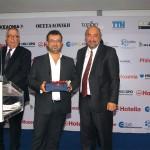 Dimitris Xydias (center) accepted the award for best brochure series on behalf of Acadimos Holidays.