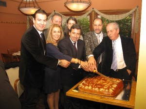 Margarita Zambeli and members of the Hellenic Association of Airline Representatives (SΑΑΕ) cutting the New Years pita last year. Ms. Zambeli has been with the association since its establishment in 1989.