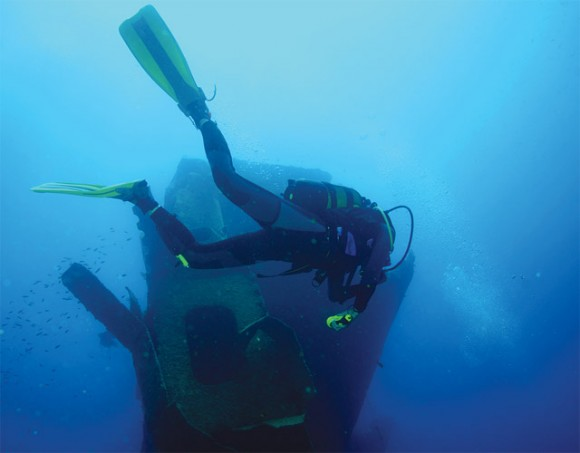 """During his speech, Deputy Culture and Tourism Minister George Nikitiadis referred to the island of Kalymnos - a popular choice for divers due to its long history of sponge diving. The photograph shows a diver who is exploring the shipwreck of the """"Thor Star"""" at Cape Roussa on Pserimos, a small island that lies in the waters between Kalymnos and Kos. Photo courtesy of Michael Paou."""