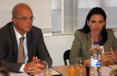 Greek Tourism Minister Olga Kefalogianni discusses the tourism sector's pending issues with the General Pan-Hellenic Federation of Tourism Enterprises. To her left is her adviser Professor Harry Coccossis.