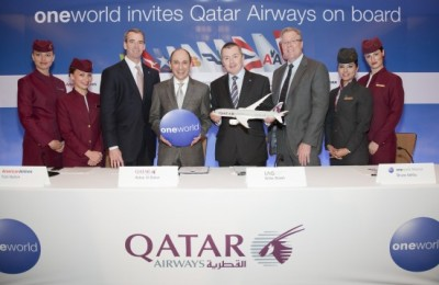 Flanked by Qatar Airways cabin crew celebrating the announcement of the airline joining the oneworld alliance are (from left), American Airlines' Chairman and Chief Executive Tom Horton, Chairman of the oneworld Governing Board; Qatar Airways CEO Akbar Al Baker; IAG Chief Executive Willie Walsh and oneworld CEO Bruce Ashby