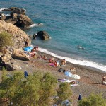 Platys Gialos - An unorganized and highly popular beach with impressive rocks and black sand.