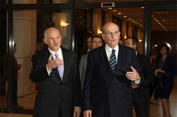 "Prime Minister Yiorgos Papandreou upon his arrival to the 18th general assembly of the Association of Greek Tourism Enterprises (SETE) at the Athens Concert Hall (Megaron Mousikis) accompanied by SETE's President Nikos Angelopoulos. Although the PM's speech referred to solutions for key issues of the tourism sector, once again SETE's president requested for a change in the Greek National Tourism Organization's operation. ""The successful models of France's Maison de la France and the U.K.'s Visit Britain show the examples we should follow,"" he highlighted."