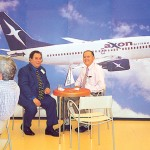 Yannos Hadjimarcou, manager in Greece for Cyprus Airways, discusses the strong investment plans of Axon with the airline's sales manager, George Papalexis.