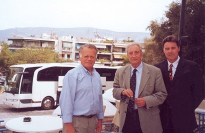 Horst Botz of EvoBus Hellas shows off the newest Mercedes coach to Hellenic Tourism Organization Chairman Yiannis Stefanides and the president of the Hellenic Tourism Coach Owners' Association, Marios Trivizas.