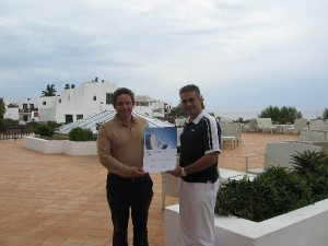"""Creta Maris Beach Resort's CEO and general manager, Andreas Metaxas, and director, Nikos Vlassiadis, holding the hotel's """"TUI Environmental Champion 2012"""" title."""