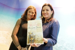 """Greek Tourism Minister Olga Kefalogianni (right) holds Victoria Hislop's latest book """"The Last Dance"""" at the Greek National Tourism Organization's pavilion at the 33rd WTM. The Last Dance is to be published next week."""