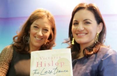 Greek Tourism Minister Olga Kefalogianni (right) holds Victoria Hislop's latest book