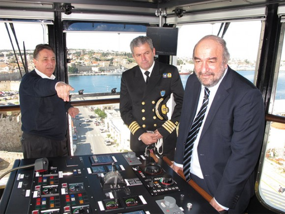 The captain of the Panama-flag cruise ship Fantasia showing the controls on the ship's deck to Deputy Culture and Tourism Minister George Nikitiadis when the ship docked at Rodos Port last month. Mr. Nikitiadis recently held a meeting with Greek cruise tourism professionals and discussed the need for the improvement of cruise ship passenger services in Piraeus and various ports in Greece. He also informed that the government is planning to expand the cruise tourism season to the winter months.