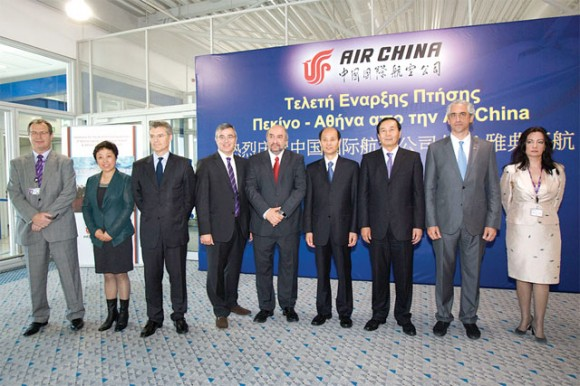 """At a ceremony after Air China's first flight to Athens International Airport from Beijing, Deputy Culture and Tourism Minister George Nikitiadis (center) said he was sure the flight would become a """"direct, non-stop, seven days a week flight."""""""