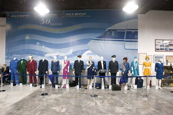 """A small display of past Olympic Airways crew and ground staff uniforms at the event held at the Olympic Airways Workers' Cultural Center. According to the cultural center, over 10,000 exhibit pieces of the country's aviation history exists. In 2009 the center submitted documentation to the Finance Ministry to set up a public benefit foundation under the title """"Aviation Museum."""""""