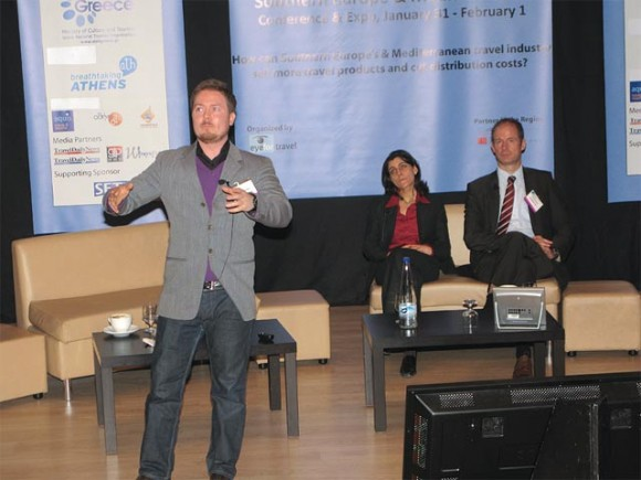 Dr. Marianna Sigala (University of the Aegean) and Rudiger Dorn (Microsoft Corporation) observe David Slocombe from lastminute.com during his lively presentation on mobile commerce in the travel industry.