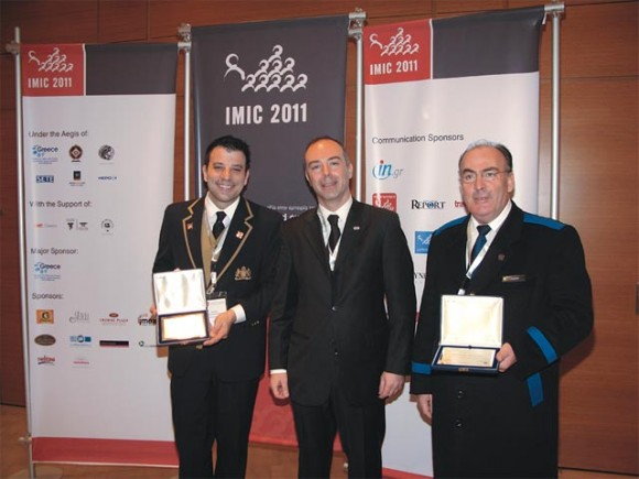 "Two ""unseen heroes"" were awarded this year with the IMIC-SITE Greece Award of Excellence. President of SITE Greece Mihalis Argiris (center) awarded the concierge of the Hotel Grande Bretagne, Apostolos Papayannakis, and the doorman of the Intercontinental hotel, Thanasis Moursiotis, and expressed his gratitude for their important contribution in the field of business tourism in Greece."