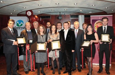 President of Manessis travel organization, Andreas Manessis (center) with the finalists of the Top 10 hotel awards for 2010. During the award ceremony, Mr. Manessis presented an honorary award of outstanding collaboration to the Amalia hotel chain.