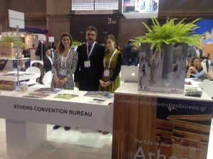 Director of Athens Convention Bureau George Aggelis at the bureau's stand at EIBTM 2012. During EIBTM, hosted buyers had the opportunity to literally see Athens everywhere, as ACB had made an agreement for a 10-second video spot on Athens to be screened throughout the duration of the exhibition. The video was screened in all modes of transport of the hosted buyers, from the airport to the exhibition venue, and on many screens in all areas of the Fira Gran Via exhibition center.