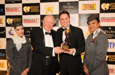 """Graham Cooke, president and founder of the World Travel Awards, with Peter Baumgartner, Etihad's chief commercial officer, celebrating winning the title for """"World's Leading Airline"""" and """"World's Leading First Class"""" airline at the World Travel Awards."""