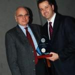 Chalkidiki Hotel Association President Grigoris Tasios (right) honors the association's former president Mihalis Athanasopoulos.