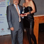 Former President of the Chalkidiki Hotel Association Gerasimos Bakoyiannis receiving his award from the association's trustee, Olga Tsapanidou.
