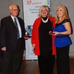 Regional GNTO representatives Persephone Triha and former Head Thomas Goutantzis receiving the award on behalf of the Regional GNTO Office of Central Macedonia–Thessaloniki by the secretary general of the Chalkidiki Hotel Association, Roula Mykoniati (right).