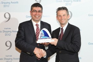 "CEO of Attica Group Spyros Paschalis (left) receives the ""Passenger Line of the Year"" award."