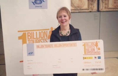 UNWTO's symbolic one-billionth tourist, Mrs Dale Sheppard-Floyd. Source: UNWTO facebook page.