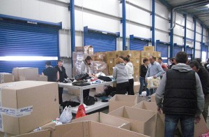 Goldair employees packing items (clothes, shoes, toys, etc.) to be shipped out to underprivileged children.