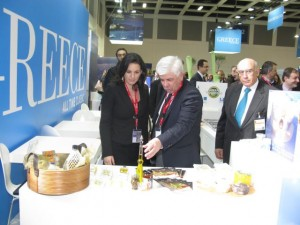 Greek Tourism Minister Olga Kefalogianni and Minister of Rural Development and Food Athanasios Tsaftaris sample local Greek products.