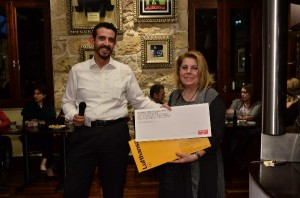 After Lufthansa's presentation the evening continued a raffle for two business class tickets by Lufthansa and Swiss to New York. Pictured is Lufthansa Group Sales Manager Greece Kostas Tzevelekos and the winner of the raffle.