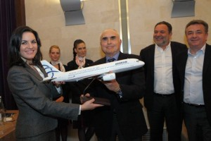 Aegean Airlines President Theodoros Vassilakis gives Tourism Minister Olga Kefalogianni a model aircraft of Aegean labeled with Greece's official site www.visitgreece.gr.