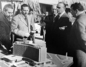 The then Prime Minister Konstantinos Karamanlis examining the model of the hotel.