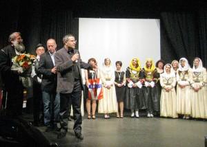 Israeli tour operator Nissan Mushaev with the Folk Dance Group of the YMCA of Thessaloniki.