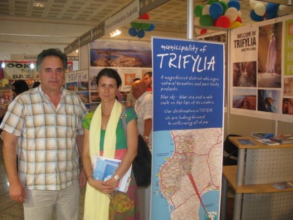 President of the Trifylia Hotel Association, Region of Messinia, Charalampos Angelopoulos and GTP's publisher, Maria Theofanopouloy, at the association's stand.