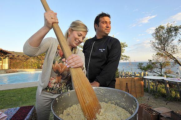 "Chefs Dina Nikolaou and Yiorgos Psyllos mixing the traditional ""Courbani."""