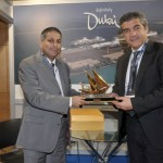Greek Shipping Minister Konstantinos Moussouroulis during his tour of the event's exhibition.